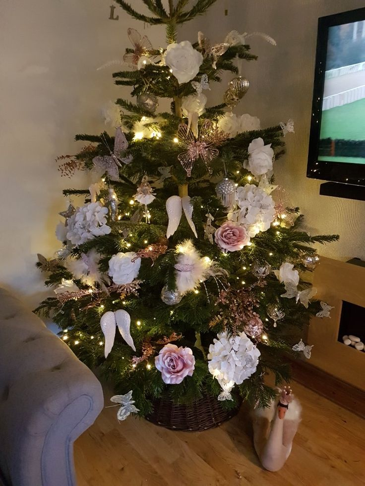 My pink Xmas tree. Silver white champagne pink tree... mainly garden centre ornaments, bit of homebase, home bargains and tk maxx on there too