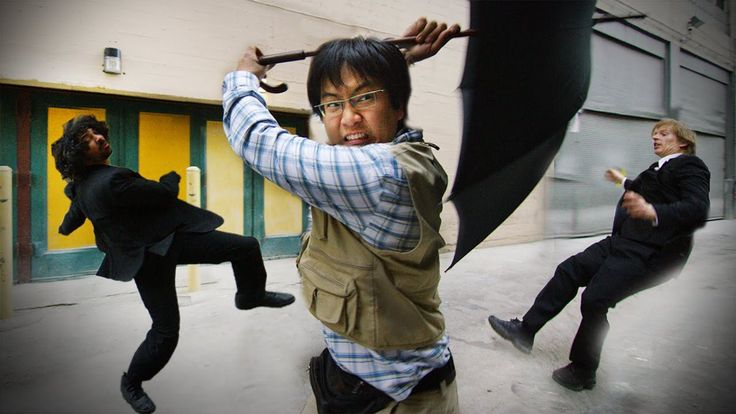 Freddie Wong Uses a Weaponized Umbrella in a Comical Street Brawl in London