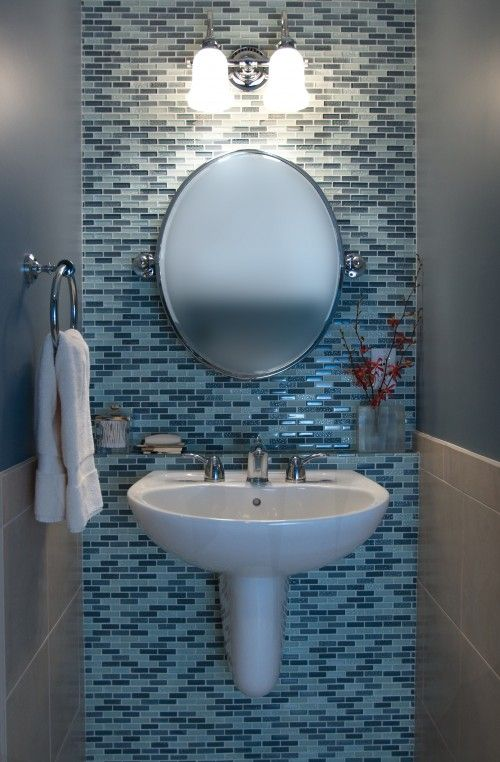 Accent tile behind mirror and sink looks good in this little half bath. Love the little ledge for things too!