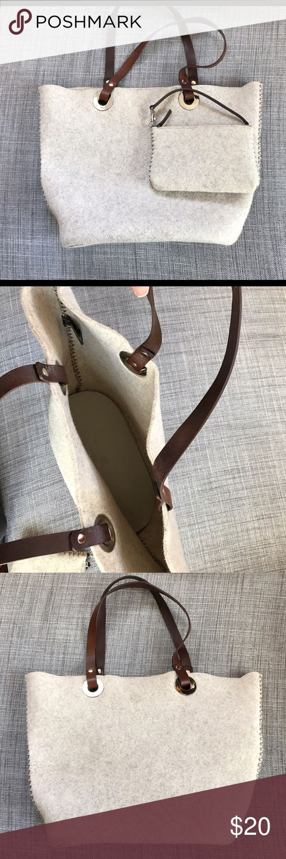 Banana Republic Felt Wool Tote with Wristlet Great wool tote and wristlet with leather straps. Bag does have a small partial whole, see pic 3. Bag could be worn on the other side and no one would notice! Banana Republic Bags Totes