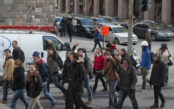 Students protesting tuition fee hikes march past Concordia University Thursday on their way to a press conference to denounce the police reaction to previous demonstrations.