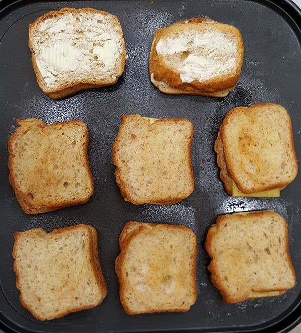 Grilled Cheese Sandwich Grilling On A Non Stick Pan Butter