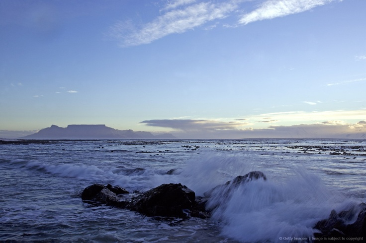 Cape Town, South Africa. Looking across to Melkbosstrand and Table Mountain at sunset.