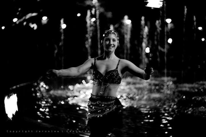A pretty black and white photo of Lexi Frost from Flamewater Circus.  Loving the fire poi in front of the fountain!