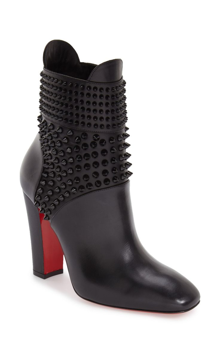 Christian Louboutin-catching tonal studs embellish a chic ankle boot  crafted from luxe Italian leather
