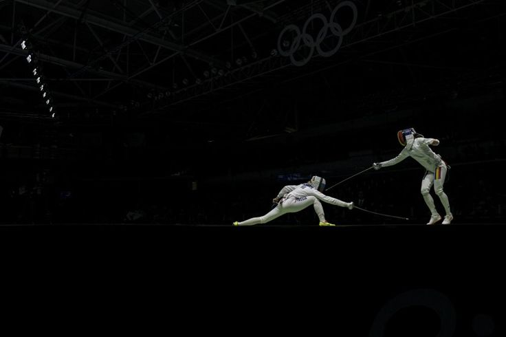Violetta Kolobova of Russia, left, vies with Simona Pop of Romania in the women's epee team fencing semifinal at the Carioca Arena 3 during the 2016 Summer Olympics in Rio de Janeiro, on Aug. 11, 2016