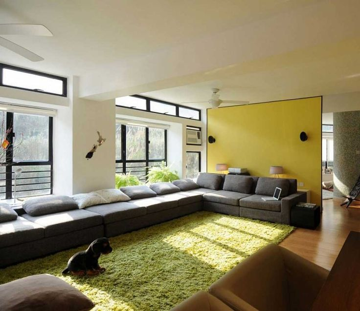 Decorating Ideas for Long Living Rooms with wooden floor and fur rugs hairy also grey color fabric