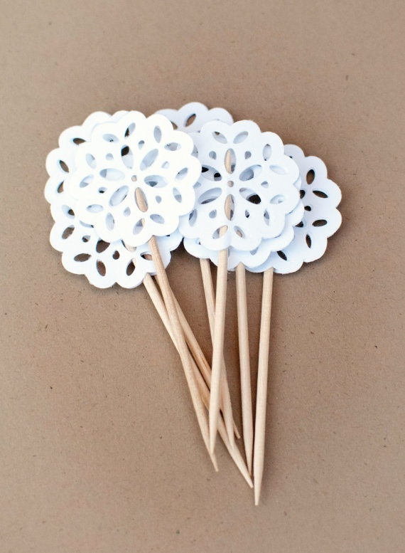 Doily cupcake toppers... Found some by Martha Stewart and backed them with colored scalloped paper.