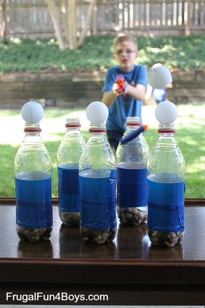 You know what makes a simple and fun Nerf target? An empty plastic bottle and a ping pong ball! Ready, aim, fire! We covered the bottles with duct tape (just for fun) and added small rocks to each bottle for weight.  You could also weigh them down with sand, but we didn't have any on …