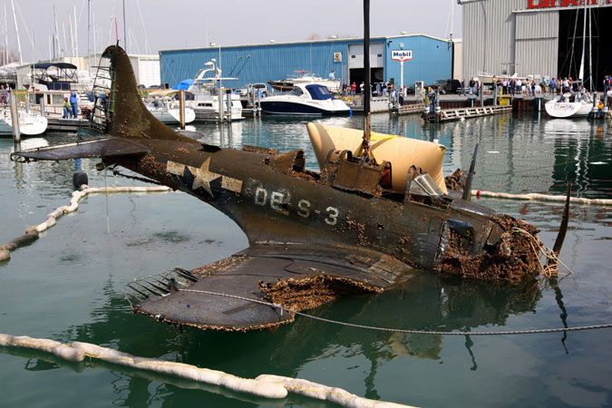a wwiiera fighter plane is brought to land from lake