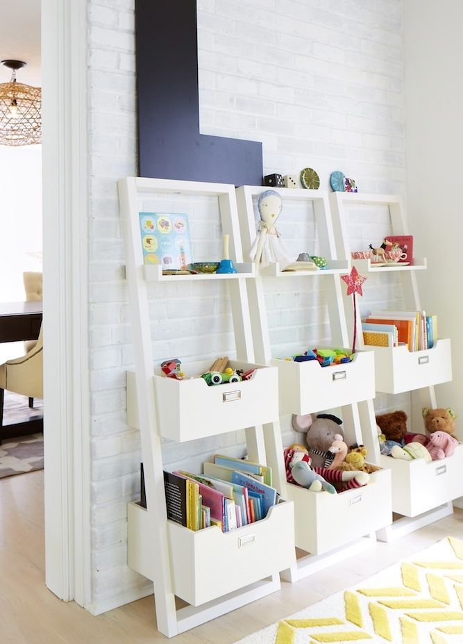 Leaning storage shelving - great idea to line up in basement for toy storage!
