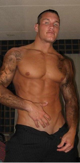 Randy Orton is so gorgeous...yummy ;) I don't know who this dude is but He's showing a lot of ahh skin?