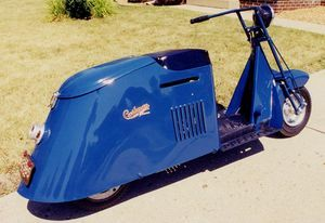 "1945 Cushman Model 52 Pacemaker motor scooter. Blue with black trim. 84"" L x 28"" W x 40"" H Made by Cushman Motor Works, Lincoln, Nebraska"