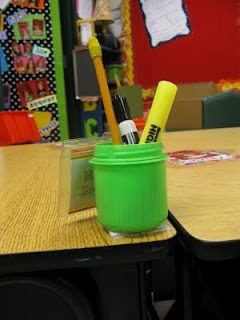 Great classroom setup ideas. She used heavy duty velcro to hold a laundry detergent cap on student desks to hold their materials.