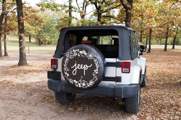 """The original tire cover that startedThe Tire Cover Shop!A white floral design circling the word """"jeep"""" is printed onto a black vinyl tire cover. -Choose from sizes 26""""-35"""" -Check out our """"how to measure your tire"""" guide before choosing a size -Tire covers are exceptional quality, made from heavy duty marine weight vinyl and a crisp printed design -Tire cover will withstand weather -Please allow 1-2 weeks for your tire cover to be made & shipped"""
