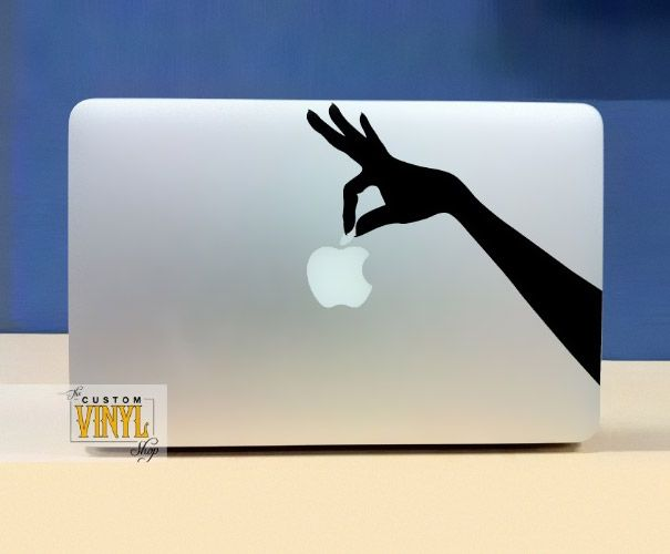 A cool Macbook sticker that will make it look as though a hand is holding the apple