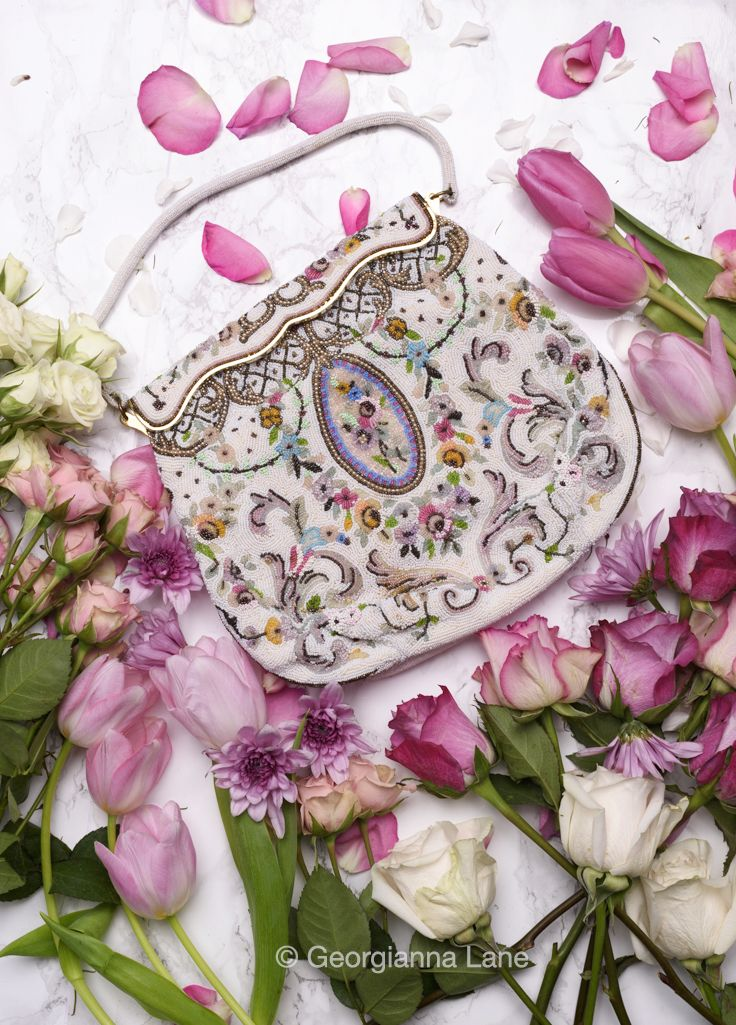 "Vintage French hand-beaded purse, a detail of which is featured in the new book by photographer Georgianna Lane ""Paris in Bloom"". Find out more and order here: http://georgiannalane.com/paris-in-bloom #paris #parisinbloombook #parisfashion"