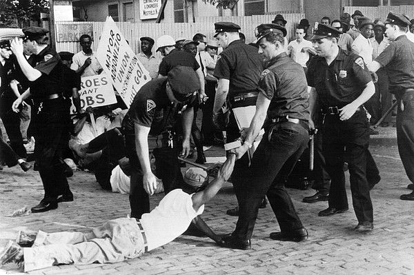 Police attempt to break up demonstration against racial discrimination in jobs at construction site of new Barrington High School, 7/3/63, Newark, NJ.