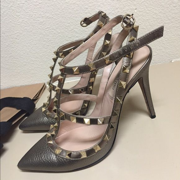 """Gold Valentino rockstud heels Exclusive to neiman Marcus gold version of the rockstud heel. Has a lot of wear left just a small scuff on the tips of the heels. Fit true to size. Probably a 3"""" heel. Comes with box Valentino Shoes Heels"""