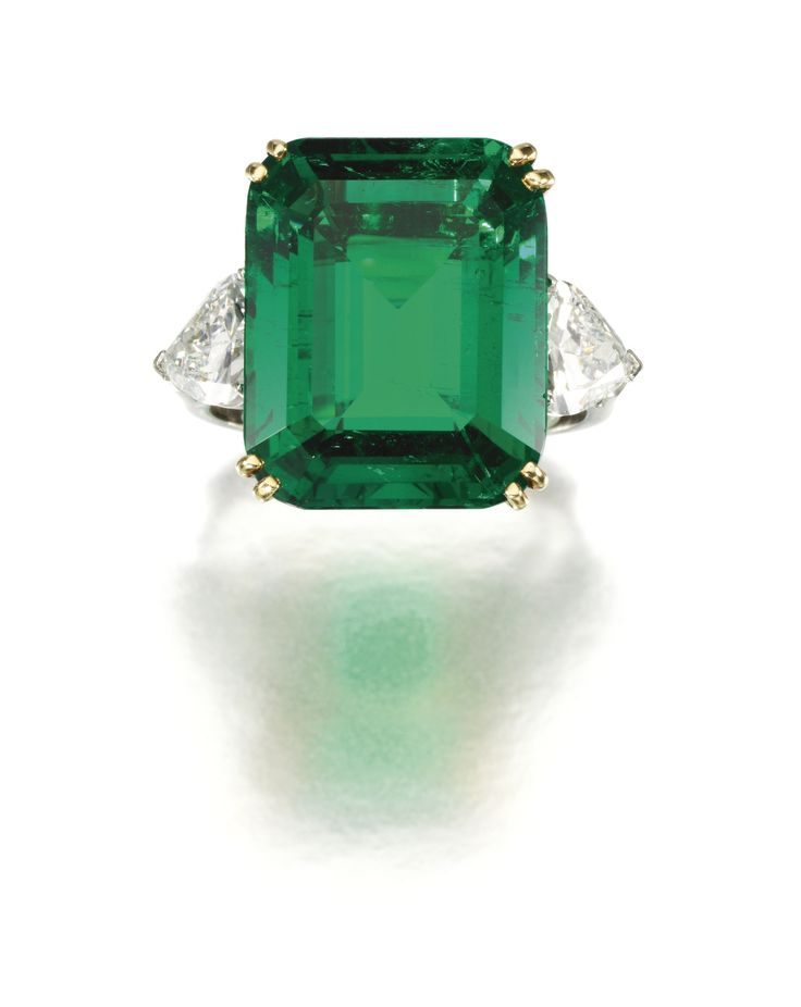 PROPERTY OF A DUCAL HOUSE: Important emerald and diamond ring. Claw-set with a 17.54 step-cut Colombian emerald, between pear-shaped diamond shoulders, French assay marks.