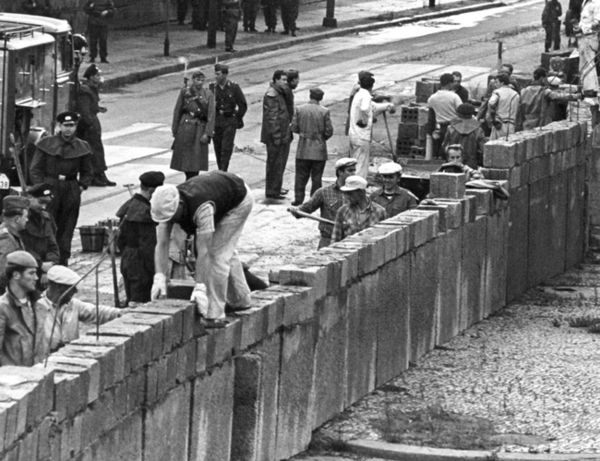 1961: East German authorities close the border between East and West Berlin August 13 and erect a wall between the sectors in response to a demand from Warsaw Pact nations appealing for a  halt of the mass exodus of East Berliners to the West. Construction of the wall in Potsdamer Platz, August 18.