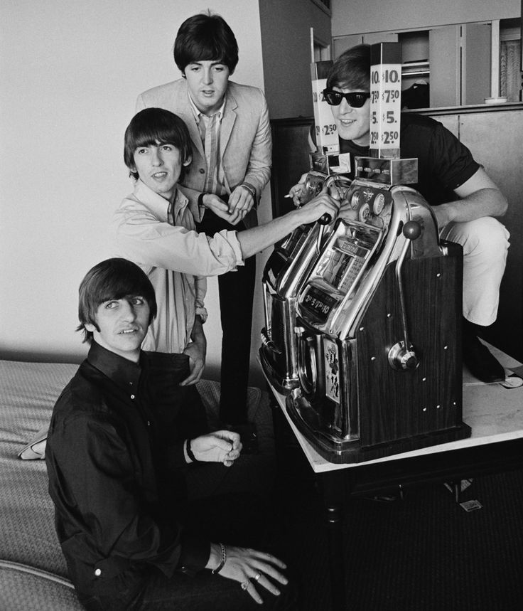 1964: The Beatles try their luck on a pair of slot machines. Left to right: Ringo Starr, George Harrison, Paul McCartney, and John Lennon. | (Harry Benson/Daily Express/Hulton Archive/Getty Images)