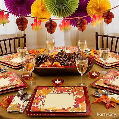 Create Visual Interest At Different Levels By Hanging Paper Decorations Over The Table Fall