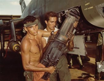 Close Air Support in SEA On the hot flight line at Phu Cat Air Base, Airmen 2nd Class Francis Branch (left) and John Sellung remove a 20mm cannon from an F-100 in October 1967. (U.S. Air Force photo)