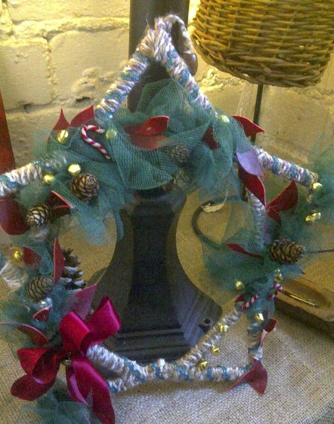 Homemade wreath from lollipop sticks and offcuts