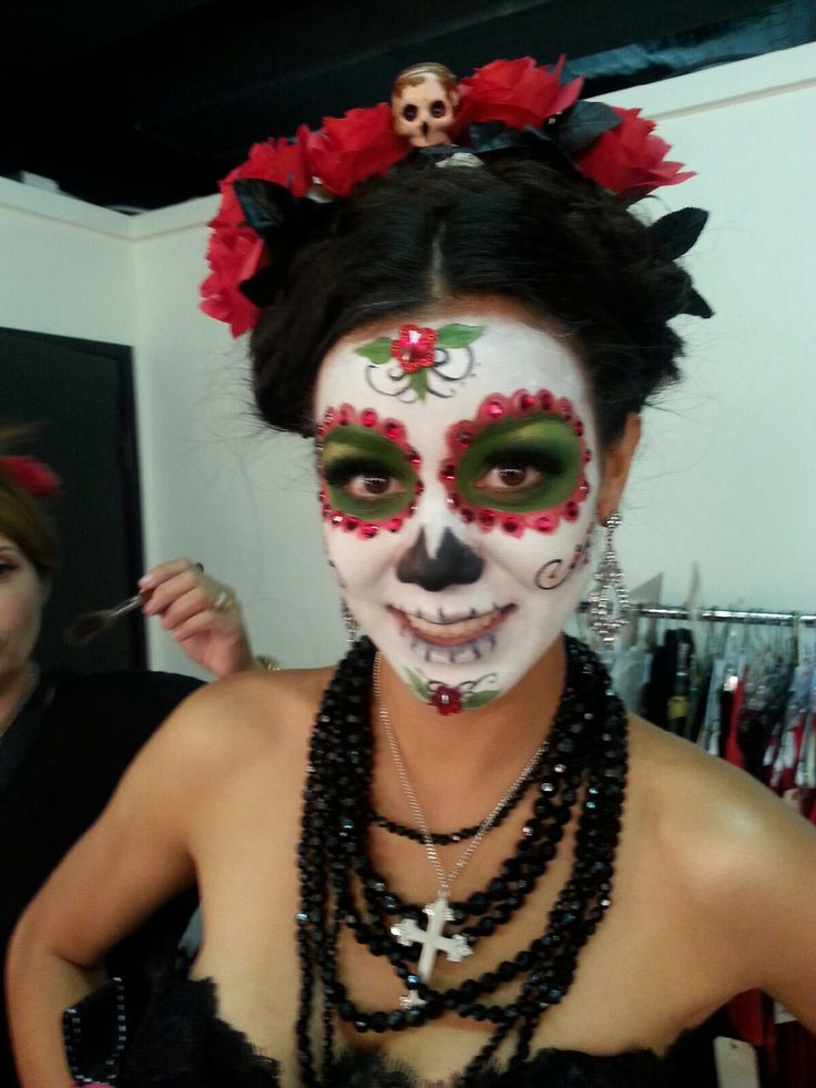 Dia de Los muertos makeup. I like the headdress with the skull incorporated.
