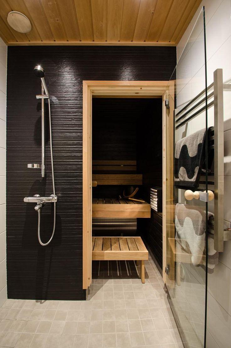 My own bathroom. Renovated in October 2014. Textiles Marimekko, tiles Italian. Wooden frames and sauna made of Finnish wood.