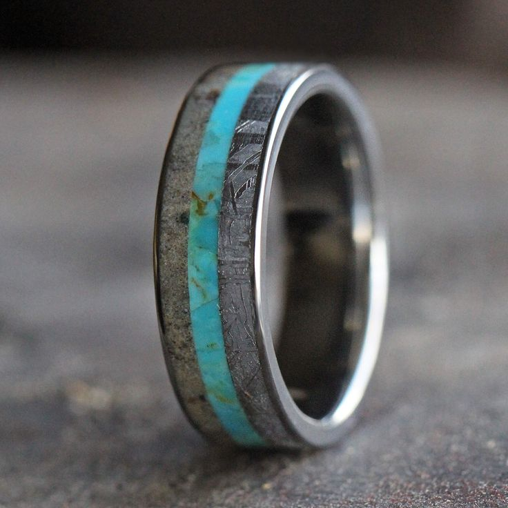 A turquoise wedding band exploding with texure and colors. This meteorite ring is crafted in titanium with inlays of dinosaur bone and turquoise. All...