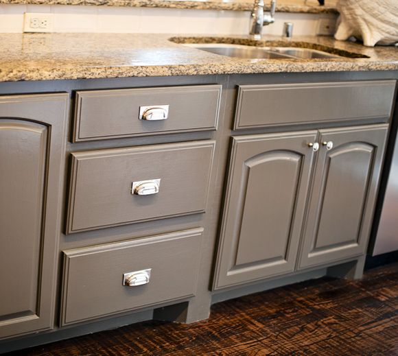 The center island and center island cabinets are porpoise Gray colors for kitchen