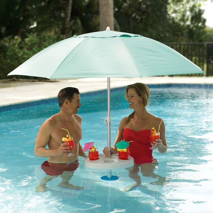 The In Pool Umbrella - This is the in-pool umbrella that provides a 7'-diameter canopy to shade bathers. Floating freely in water with a depth of 2' or greater, the umbrella uses a rust-proof aluminum pole with an affixed 6-lb. counterweight at its bottom to stay in position in breezes or waves, whether in a pool, lake, pond, or ocean.