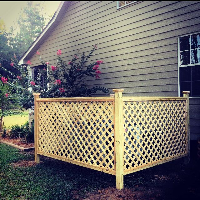 Lattice fence to hide HVAC unit and can be used as a trellis to grow flowers! I plan to add a light to the front 2 poles to add additional yard lighting!