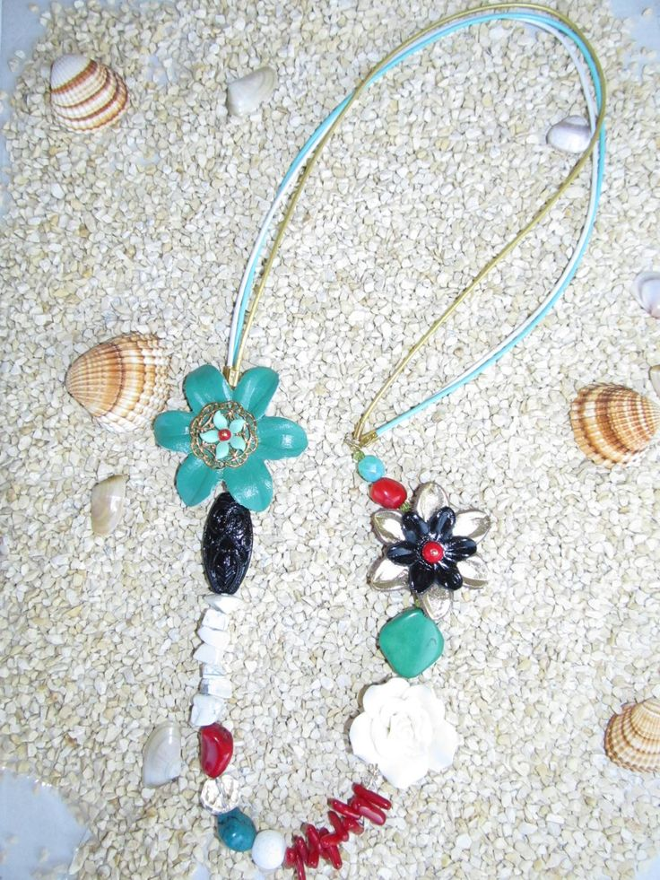 Handmade necklace (1 pc)  Made with leather flowers, fimo beige flower, gemstones, glass beads, metals and leather cords.