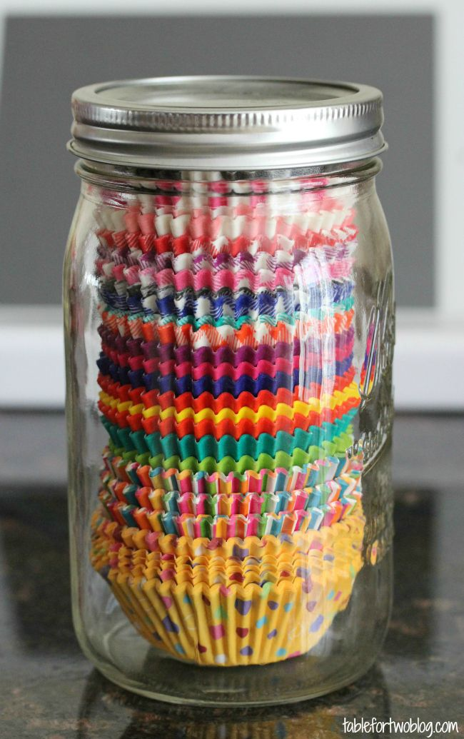 If you use mason jars to store dry ingredients and other non-perishables in your pantry, keep the look uniform by filling a few more with stacks of baking supplies, like these perfectly sized cupcake liners. See more at Table for Two »