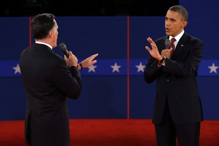 #Picsof2012 Republican presidential nominee Mitt Romney and U.S. President Barack Obama spar over energy policy during the second presidential debate at Hofstra University, in Hempstead, N.Y., Tuesday, Oct. 16, 2012. A combined 191.8 million people tuned in to watch U.S. President Barack Obama face off with Republican rival Mitt Romney in three U.S. presidential debates which addressed issues ranging from the Benghazi embassy attacks, to the economy, to Big Bird.