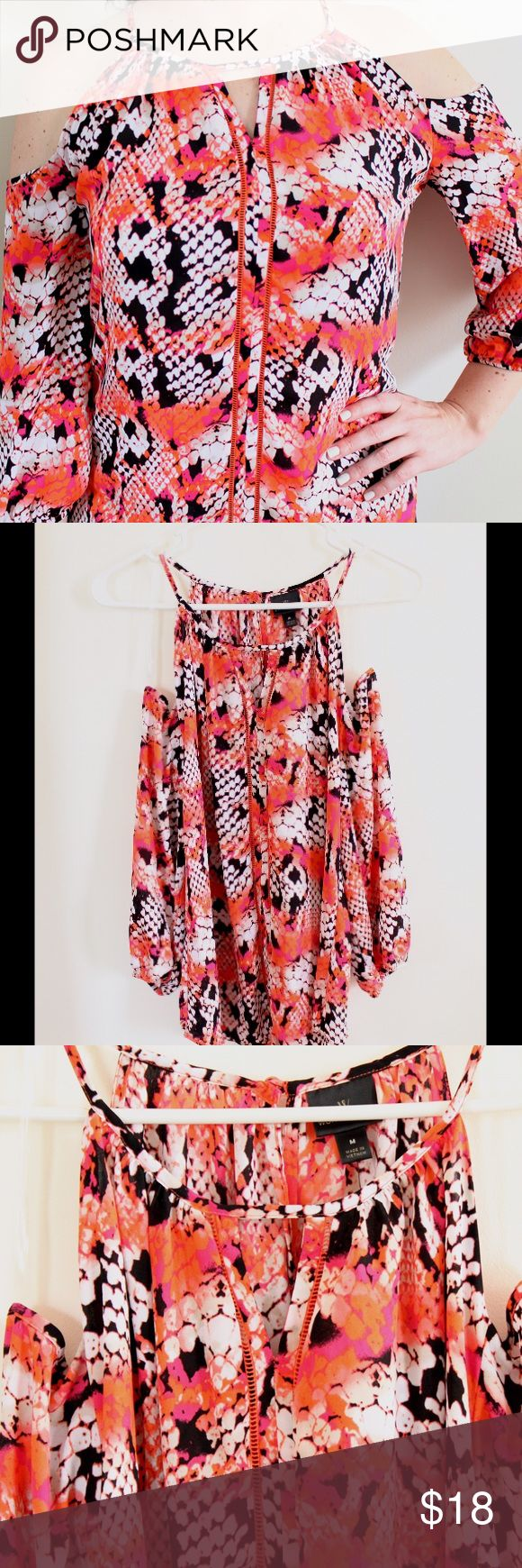 """NWT Cold Shoulder Snake Skin Blouse SZ M Brand new Worthington cold shoulder blouse. So much fun detail on this top! Bright pink and orange snake skin print. Flowy and 3/4 sleeves with elastic band at bottom. SZ M, approx 26"""" long in the front and 27"""" long in the back. No trades, offers welcome! Worthington Tops Blouses"""