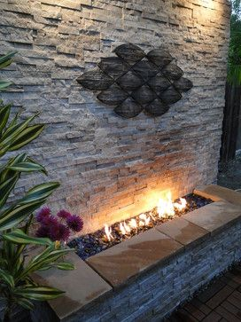 Outdoor Stacked Stone Fireplace contemporary patio.  Great!  And the fire is contained; in the south where it is dry, this is really important.