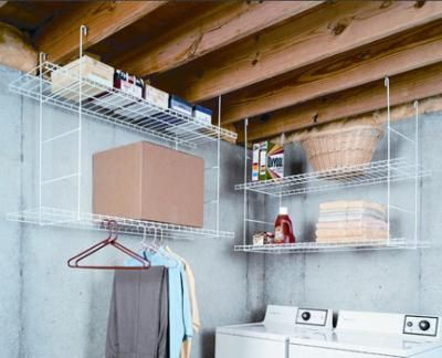 If your laundry is in an unfinished basement you can still have it be organized. Rafter-hung shelves create storage where none would otherwise be possible and a hanging area to allow air dry clothes to hang dry.