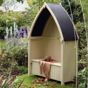 I like this vaguely boat-shaped covered seat for a seaside garden - useful storage available below the seat for cushions etc.