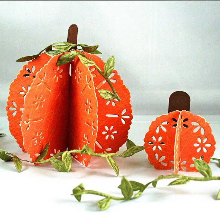 <3  <3 Decorate your Thanksgiving table with these lovely 3-D paper pumpkins from Spellbinders. The paper comes with the eyelet design.
