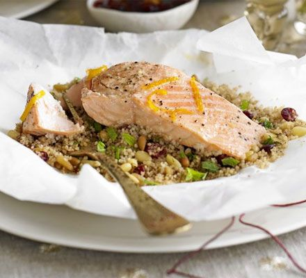 Whip up some fruity couscous then place with fish into parchment to be baked in a pouch