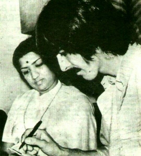 George Harrison with Lata Mangeshkar.