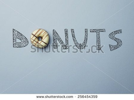 """Donut with a doodle text """"Donuts"""" concept"""