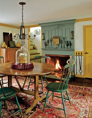 DINING ROOM FIREPLACE  A fireplace in the dining room is a natural fit in a farmhouse, creating a warm place to share meals. A collection of eel spears lines the mantel.