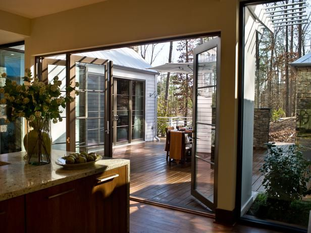 ❥ 2012 HGTV Green Home.  Kitchen.  Architectural outswing folding patio doors open to the home's barbecue courtyard, a second dining area. Doors may remain open to foster conversation between the hostess and guests.