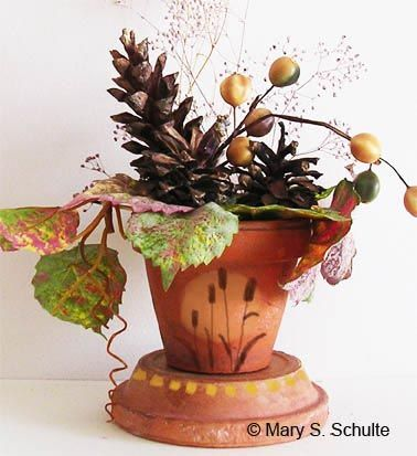 A painted clay pot for fall is very easy to make, since the pot already has a fall color.