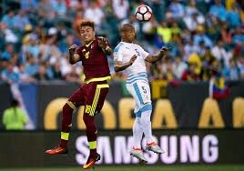 Uruguay 0 Venezuela 1 in 2016 in Philadelphia. Adalberto Penaranda and Carlos Sanchez jump up for the ball in Group C at Copa America.